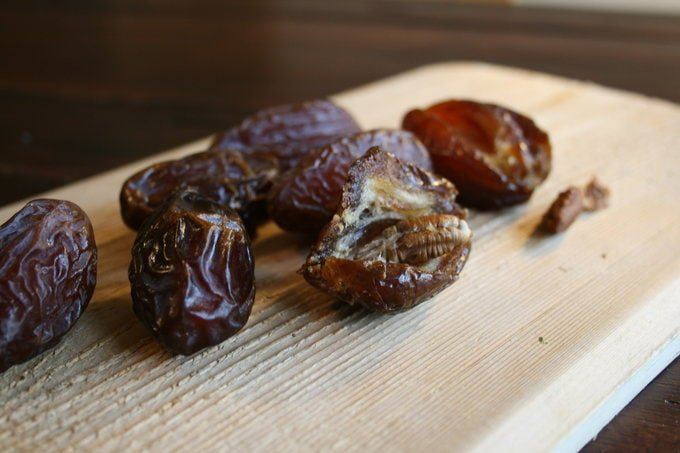 dates on a wooden cutting board