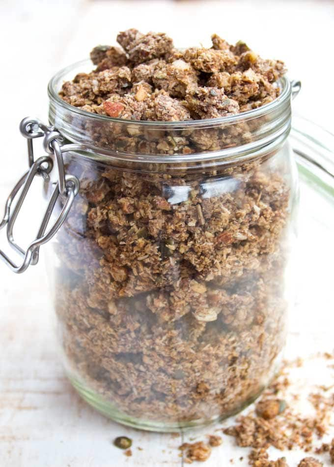 a glass jar filled with homemade grain free granola