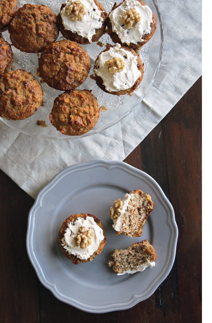 a cake stand with healthy carrot cake muffins