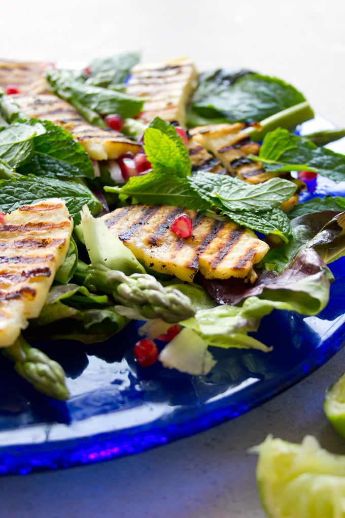 grilled halloumi on a green salad