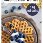 low carb waffles topped with berries and sour cream