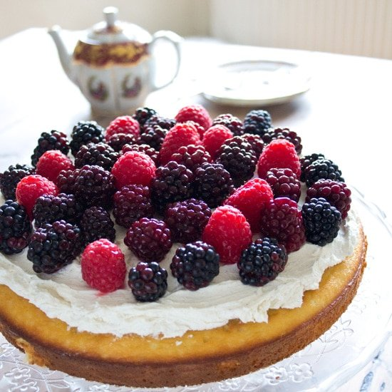 almond flour cake with mascarpone frosting and berries