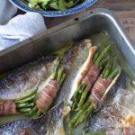 Roast sea bass traybake with bacon-wrapped beans, guys!