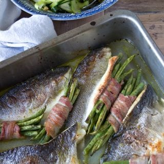 Roast sea bass traybake with bacon-wrapped beans, guys!