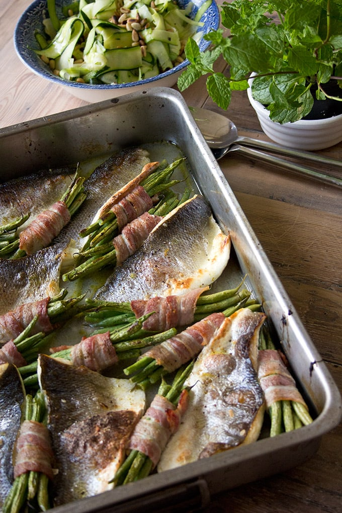 roasted sea bass fillets in a casserole dish