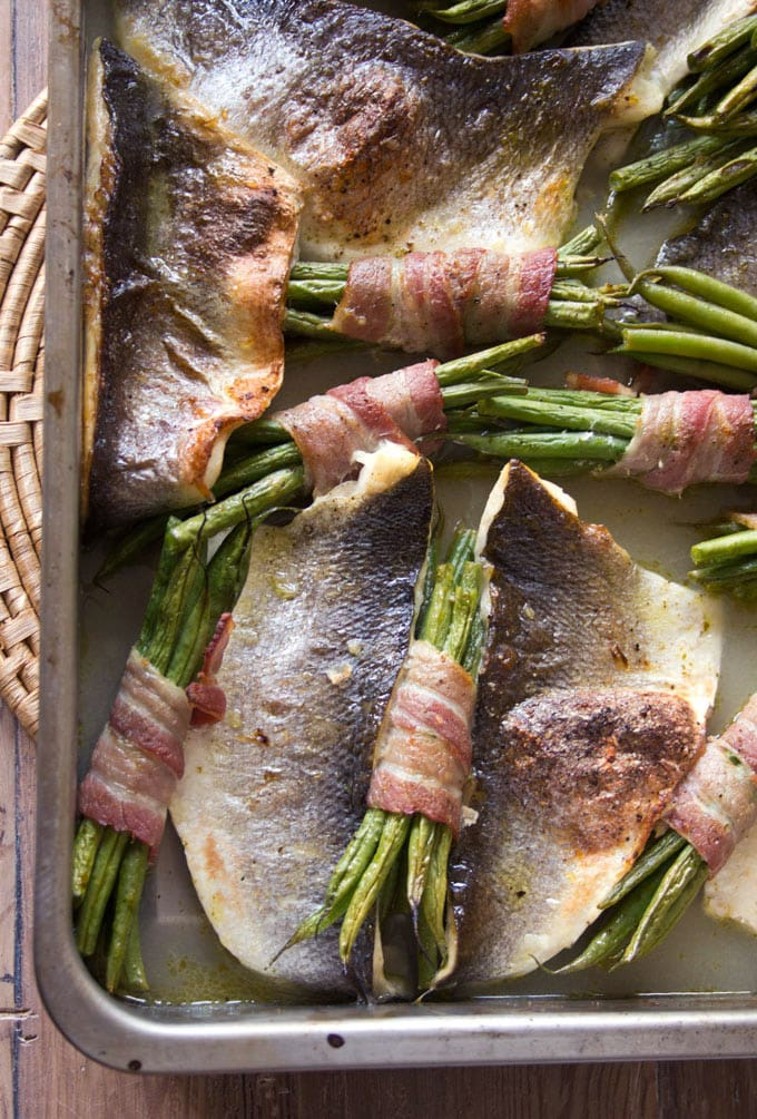 Get some Omega 3 into you with this quick, light and impressive-looking dish. Roast sea bass traybake with bacon-wrapped beans, guys!