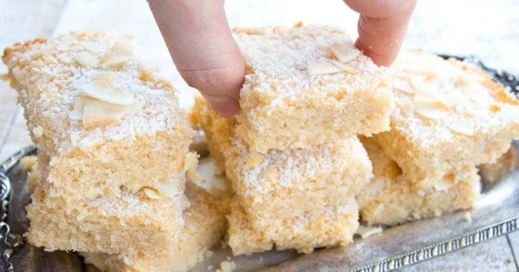 These moist, chewy Keto blondies are so easy to make and perfect for coconut lovers! They contain coconut flour, coconut oil, desiccate coconut AND coconut cream. The recipe is low carb, gluten free and sugar free.