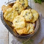 Crunchy and incredibly cheesy: These gluten free and low carb cheese thyme crackers are made with coconut flour. Perfect as a satiating snack or as a grain free side for a warming bowl of soup.