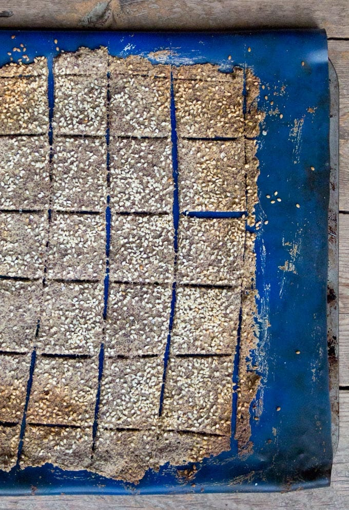 flaxseed crackers on a silicone baking mat