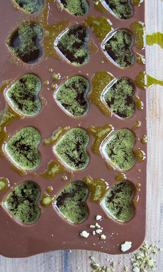 liquid matcha chocolate mix in a chocolate mould