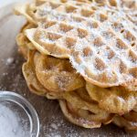 sugar free powdered sweetener on a stack of waffles