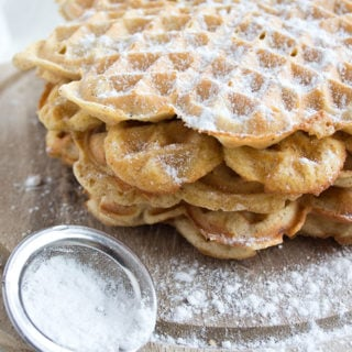 a stack of fluffy almond butter coconut flour waffles