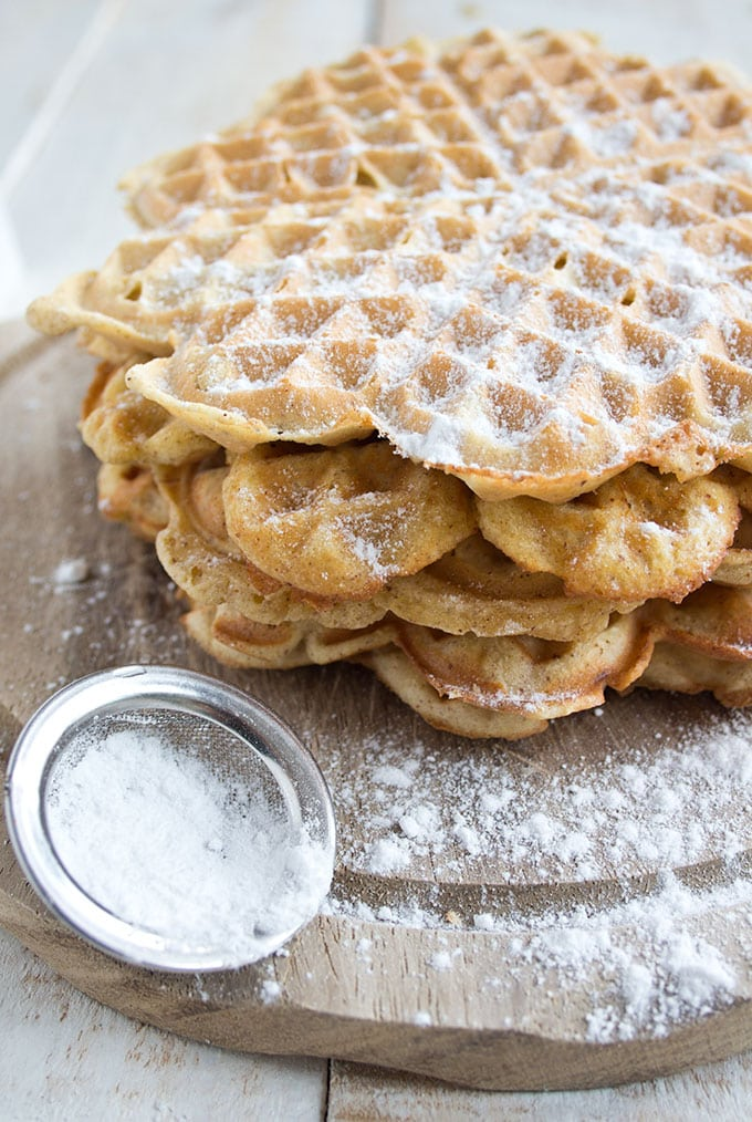 stack of coconut flour waffles with powdered sweetener