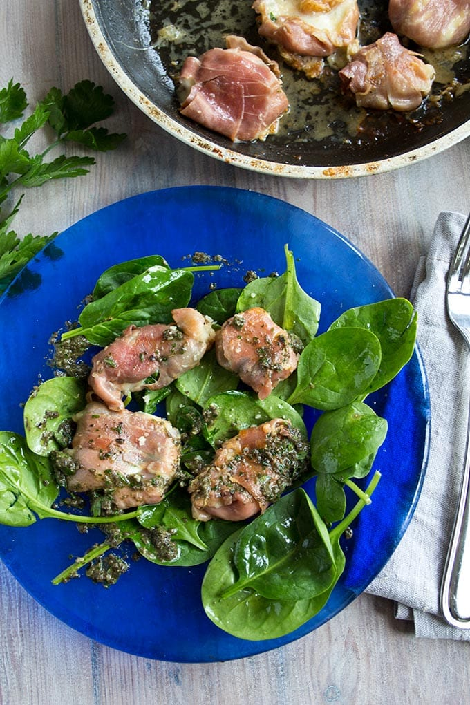 Mozzarella Prosciutto Parcels with black olive Tapenade on a bed of salad and a frying pan