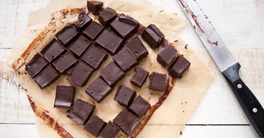 fudge cut into squares and a knife
