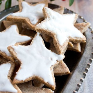It's time to get festive the healthy way: German Cinnamon Stars AKA Zimtsterne are a traditional gluten free German Christmas cookie recipe. This version is sugar free and diabetic-friendly.