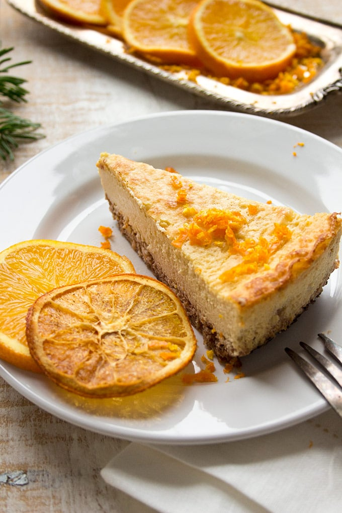 a slice of orange cheesecake on a plate