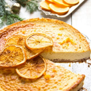 A showstopper cake to crown a festive meal or mark a special occasion. This rich and creamy spiced orange brandy cheesecake is sugar free, low carb and gluten free.