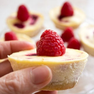 mini raspberry cheesecake topped with a raspberry