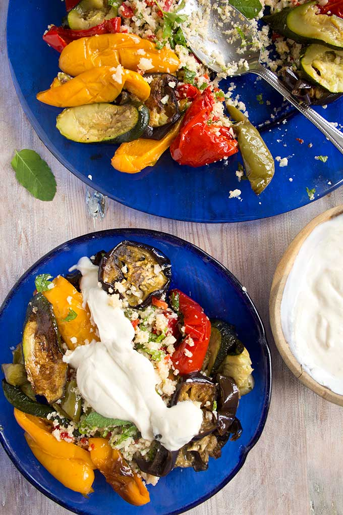 A light low carb lunch or dinner that is bursting with flavour. This Moroccan cauliflower rice with roasted vegetables is served with a yoghurt tahini dip.