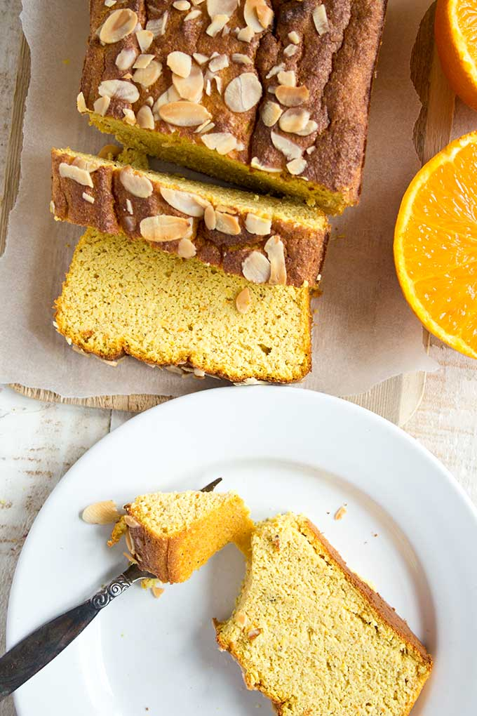 slice of orange almond cake on a plate