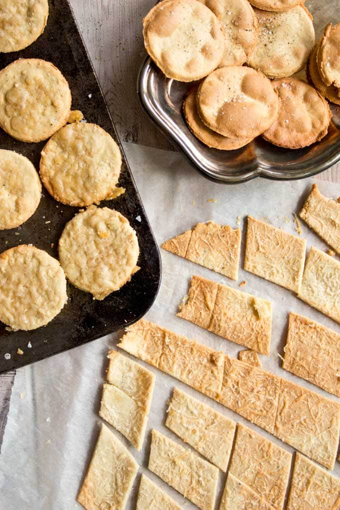 a selection of round and square paleo low carb crackers with and without cheese topping
