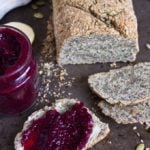 a loaf of paleo bread and a slice of bread with jam
