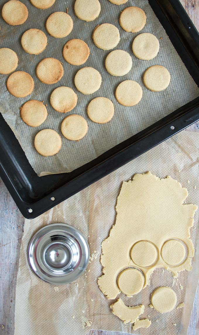 A baking tray with low carb keto shortbread cookies and rolled out cookie dough