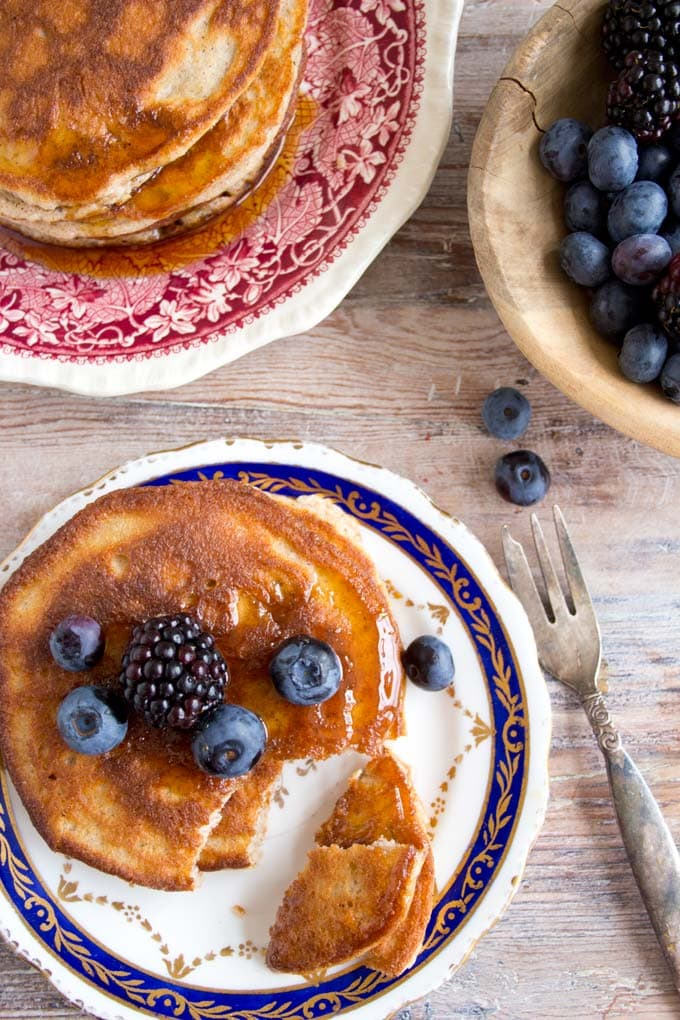 Paleo coconut flour pancakes on a plate with berries