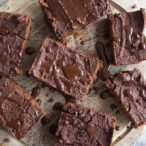 Fudgy Pumpkin Brownies on a round wooden tray