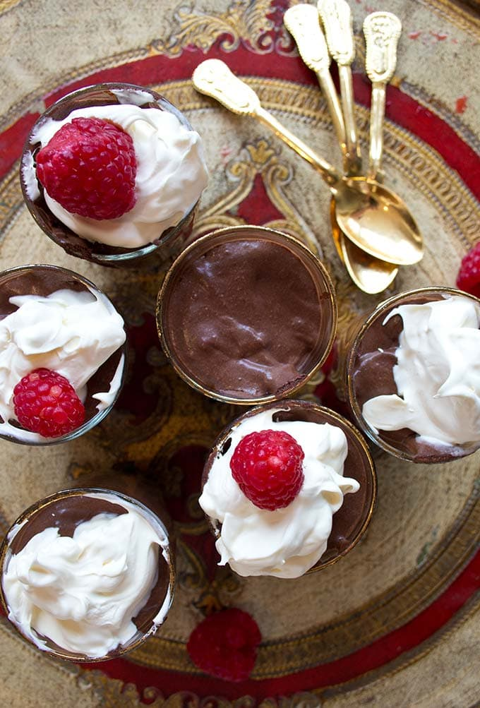 A tray with low carb chocolate mousse portions topped with cream