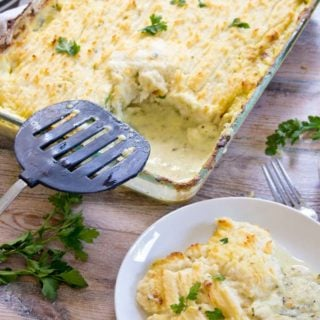 Comfort food at its best - a deliciously creamy fish pie with a cauliflower mash topping that will make you come back for seconds! Low carb and keto-friendly.