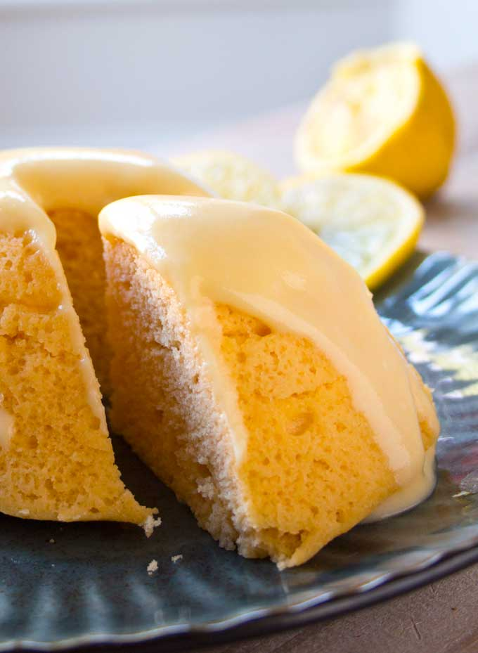 Closeup of a sugar free lemon mug cake slice topped with lemon icing