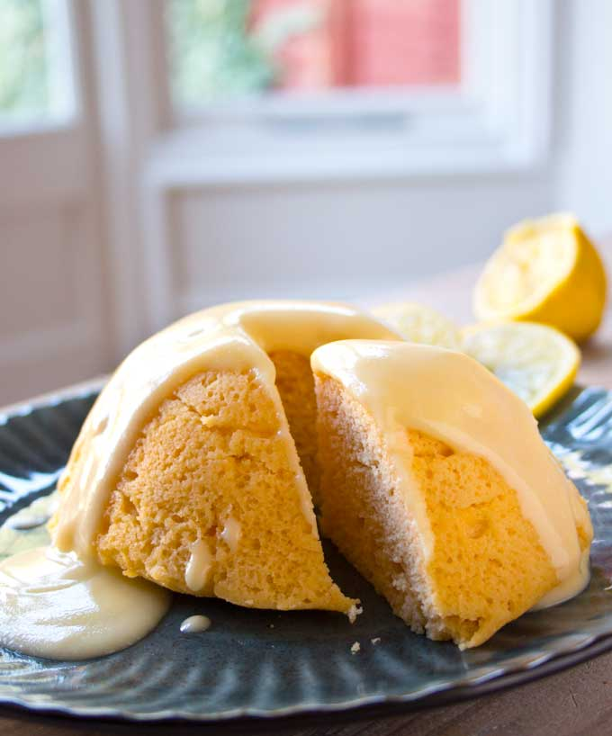 A sliced sugar free lemon mug cake on a plate