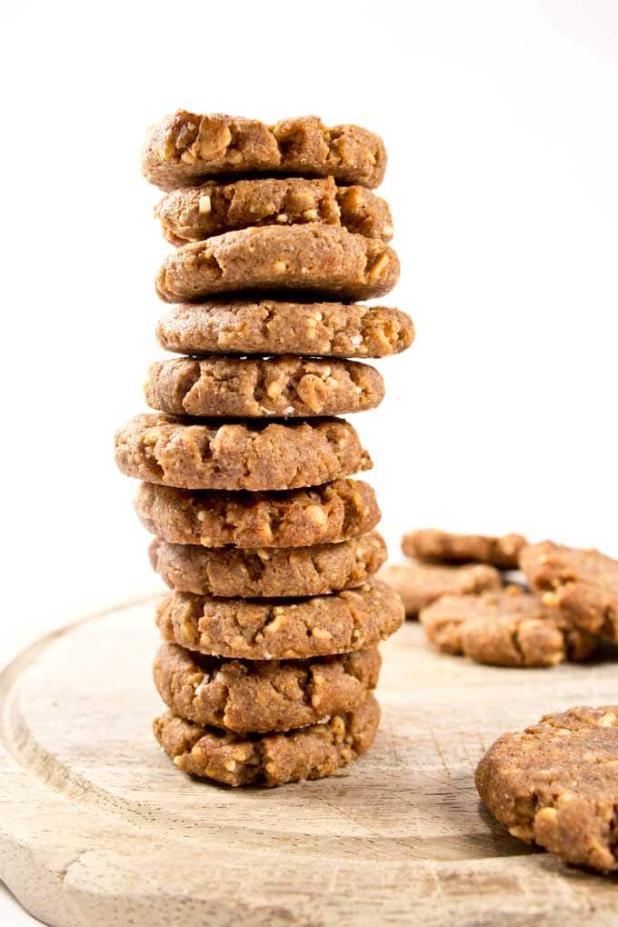 A stack of low carb peanut butter cookies on a wooden board