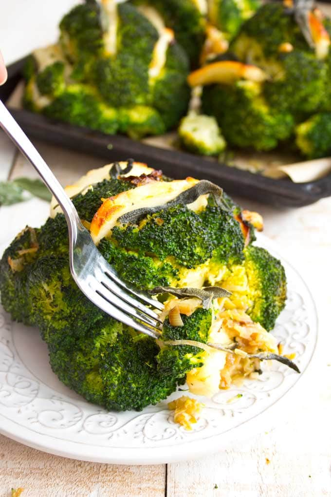 a broccoli head stuffe with halloumi and a for on a plate