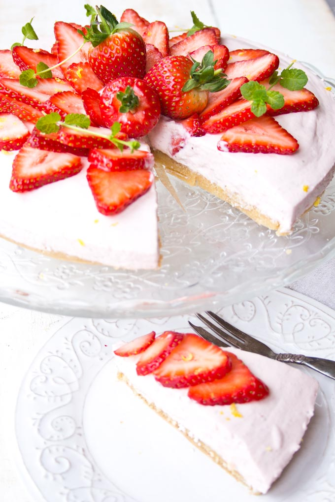 A slice of low carb strawberry cheesecake on a plate