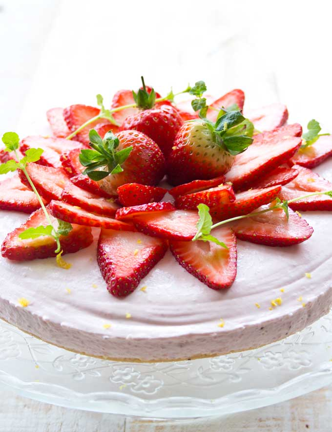 A sugar free strawberry cheesecake decorated with strawberries