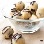 keto cookie dough balls with chocolate chips and chocolate ganache in a bowl