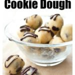 keto cookie dough balls studded with sugar free chocolate chips and topped with chocolate ganache in a glass bowl