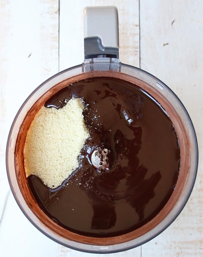 Melted chocolate and almond flour in a food processor