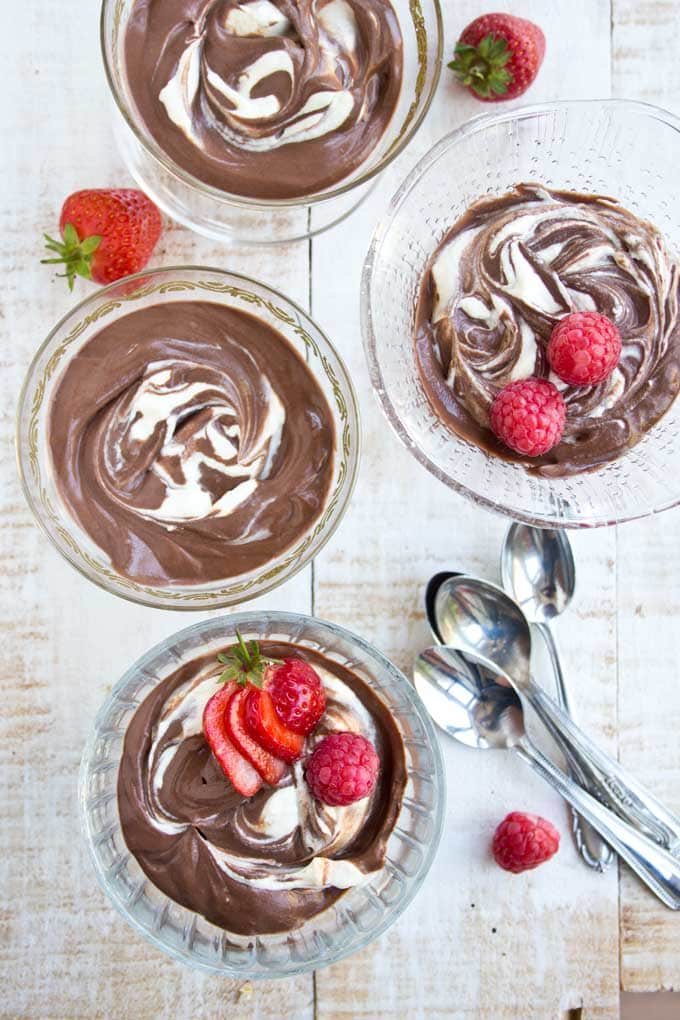 4 bowls of chocolate mascarpone mousse and spoons