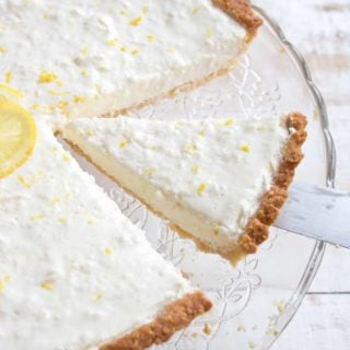 Cutting a slice of low carb lemon cheesecake tart