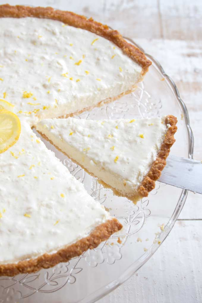 Cutting a slice of low carb cheesecake