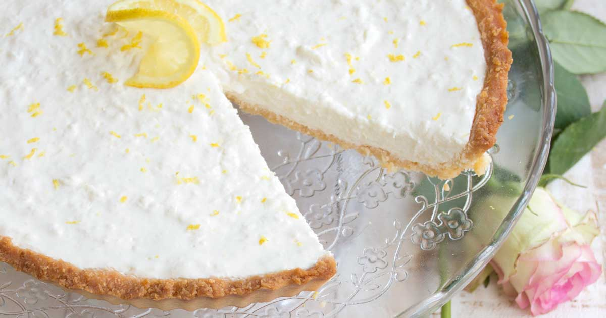 Zingy and refreshing, this low carb lemon cheesecake tart is a heavenly creamy highlight to any meal. Your family will never guess it's sugar free! Keto, gluten free and diabetic-friendly.