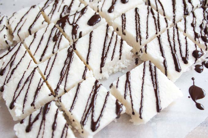 Chocolate drizzle on coconut squares