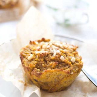 Healthy pumpkin muffin topped with hazelnuts on a plate