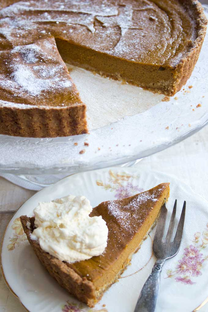 A sugar free pumpkin pie and a slice of pumpkin pie