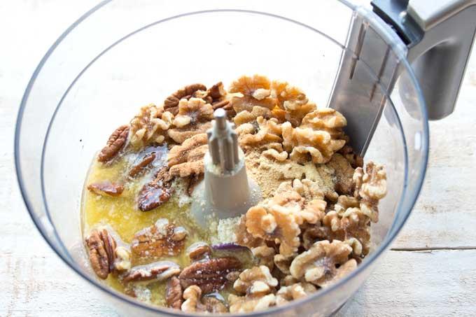 Preparing low carb pumpkin cheesecake - nuts for the cheesecake crust in a bowl