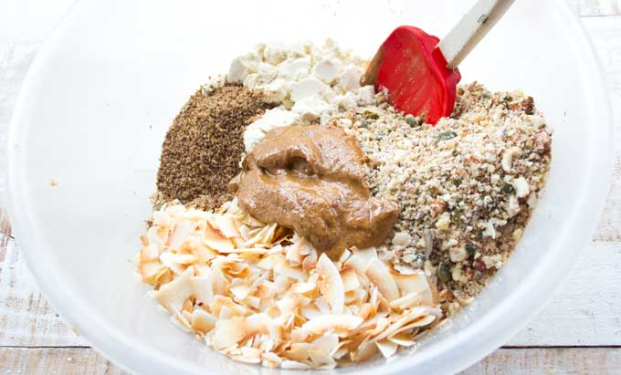 ingredients for sugar free low carb granola in a bowl with a spatula